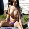 Slutty European Tranny with awesome titties shoving a buttplug in her butt while taking sun outdoors